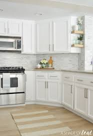 How To Repaint Kitchen Cabinets White by How To Repaint Kitchen Cabinets