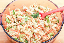 broccoli carrots and olives in a cold pasta salad stock photo