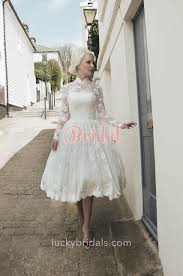 long sleeve ivory lace tea length illusion ball gown wedding dress