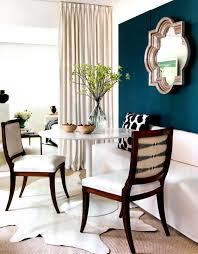 dining room dark wood chairs with white wood table and wall
