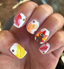 picture of leaves and turkey nail design with gems