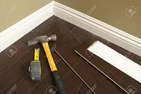 Laminate Flooring Molding Hammer Laminate Flooring And New Baseboard Molding Abstract