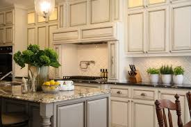 granite countertops for ivory cabinets 2 tone kitchen transitional kitchen m e beck design