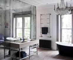 antiqued mirror glass modern bathroom london by rupert