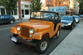 orange jeep cj old parked cars 1972 jeep renegade