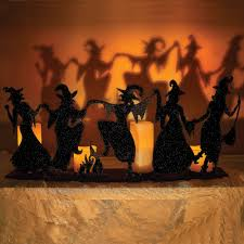 adorable dancing witches candle holder cast dramatic shadows onto