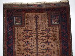 antique baluch camel ground prayer rug with tree of design