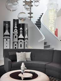 photos hgtv family room features chic gray sofa and black white
