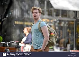 blonde man walking in the street with a backpack vienna austria