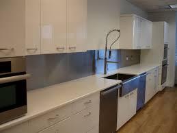 fascinating white kitchen with stainless steel backsplash