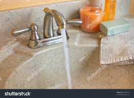 typical bathroom sink running water soap stock photo 87598774