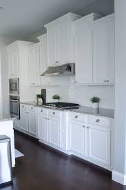 this is beautiful love the corner cabinet as well gray and white thinking this is exactly what i want with the white cupboards white gray countertop