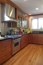 Wood Kitchen Cabinets With Wood Floors by Honey Oak Kitchen Cabinets With Black Countertops Pearl Or