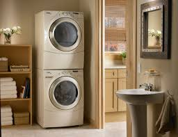 organizing small laundry room spaces with stacked washer dryer in