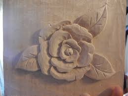 carving a camelia flower in wood