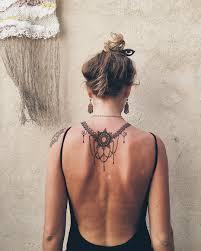 ornamental back tattoos on