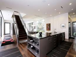 architecture kitchen multi generational family home by stern and using retangular modern dark grey kitchen island including rustic solid cherry wood kitchen flooring and black granite kitchen counter tops image