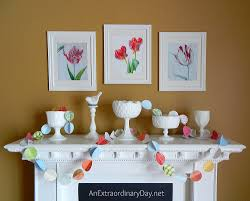 simple dramatic white mantel for spring with color pops an
