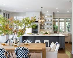 white kitchen countertop design and blue abstract printed chairs