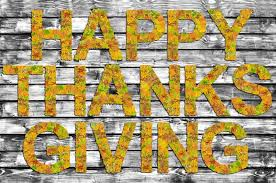 happy thanksgiving written on b w wooden board with words made of