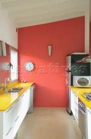 Red Walls In Kitchen - amee032 16 red feature wall with clock in kitchen with