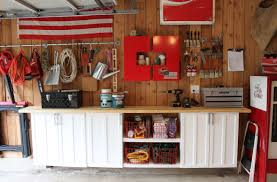 simple garage organization with wood wall mounted cabinet with simple garage organization with wood wall mounted cabinet with table top wood wall cover panels and stainless steel hooks ideas