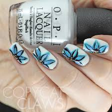 copycat claws freehand blue flower nail art