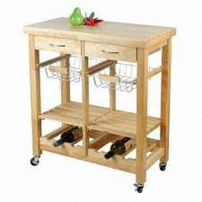 oak kitchen trolley with drawers wire baskets shelves and wine