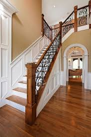 Wood Banisters And Railings Entryway With Rustic Wood Floors L Shaped Stairway Shiplap Wall