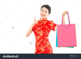 new year shopping woman hold with shopping bag and thumb up for showing big