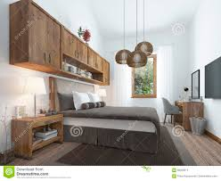 bedroom loft style with wooden furniture and white walls stock