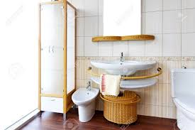 bright bathroom interior with clean bright and clean bathroom interior with rattan fixtures stock