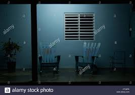 porch at night empty rocking chairs on porch at night stock photo royalty free