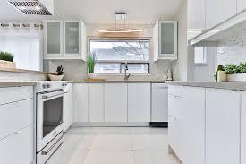 white kitchen cabinets with vinyl plank flooring luxury vinyl tile archives floor factors