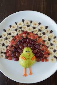 create a healthy fruit platter for thanksgiving in the shape of a