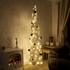 white pre lit slim line pop up christmas tree with decorations