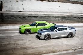 chevy camaro vs dodge charger totd 707 hp dodge challenger srt hellcat or 580 hp camaro zl1 wot