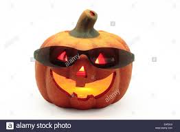 typical halloween pumpkin with sunglasses on white background