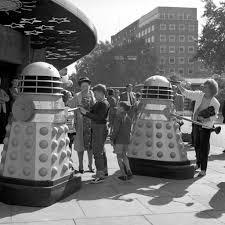 children meeting robot daleks outside the planetarium baker