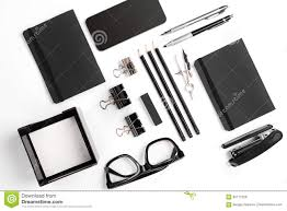 mix of office supplies and business gadgets on a modern desk stock