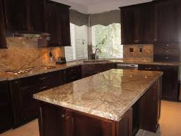 transitional kitchen cherry cabinets with golden beaches granite