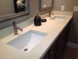 white sink black countertop concrete sinks and countertops brown yellow stone wall tile oval