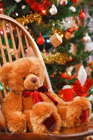 Teddy Bear Christmas Decorations by Christmas Interior With A Teddy Bear On A Chair In Front Of A