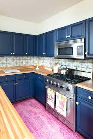 break out the paint blue kitchens are tras chic right nowdark gray