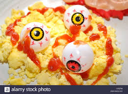 halloween breakfast yellow and red eyes with scrambled eggs stock