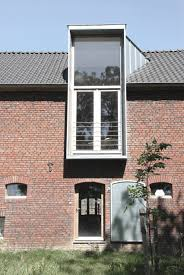 jeanne dekkers converts dutch farmhouse into contemporary living space