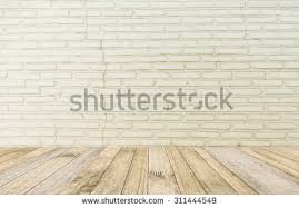 white brick wall wood floor background stock photo 534081850