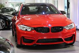 red bmw bmw m4 in ferrari red looks gorgeous