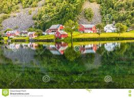 norwegian country houses in the mountains on lake shore stock