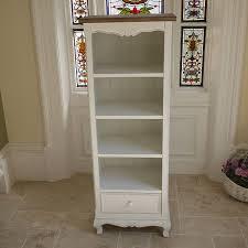 narrow white bookshelf bookcase shabby chic storage candle and blue
